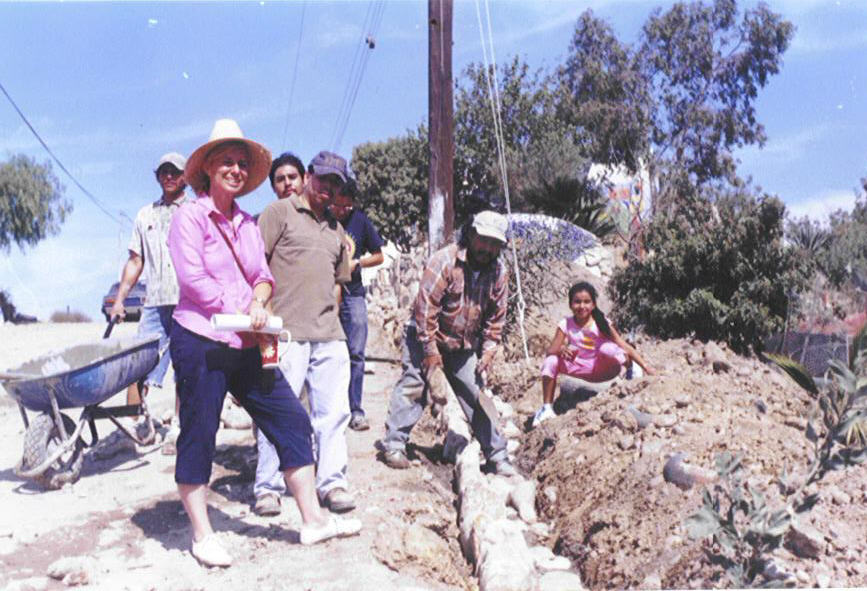 Christine Brady and parents work on Street wall