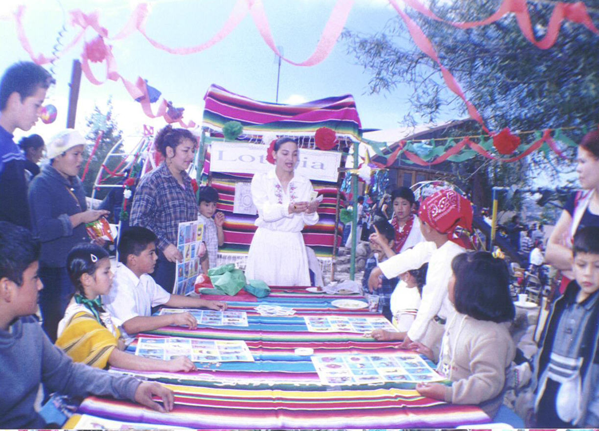 Colegio La Esperanza students and guests play Loteria at 2003 Kermesse