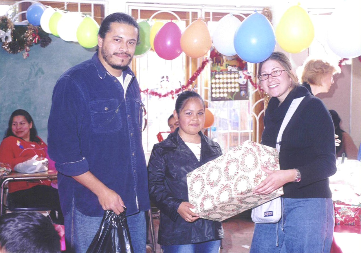 UCSD's Neuro Science Dept's Mike Baca and Tanya Levi help distribute Christmas presents at Colegio La Esperanza Xmas 2003
