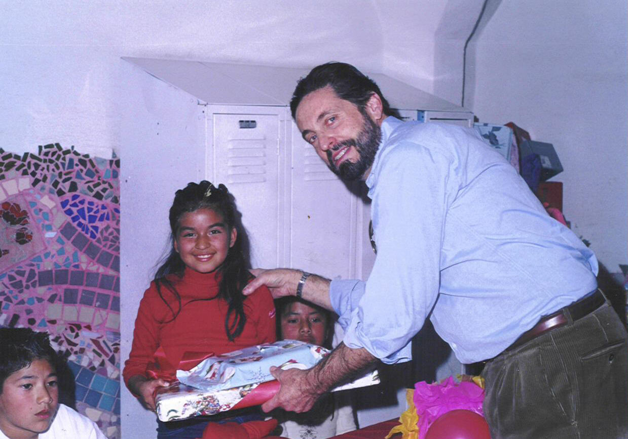 Peter_Calderon_Princeton Class of 1965 helps with Gift giving at Colegio La Esperanza